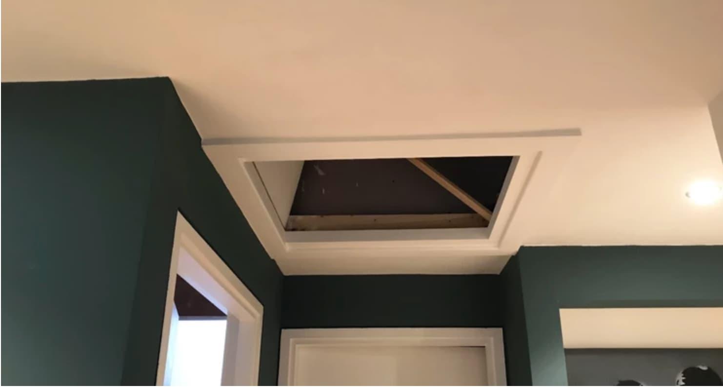 open hatch built into a ceiling