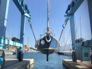 sailing boat yacht being hauled out by crane