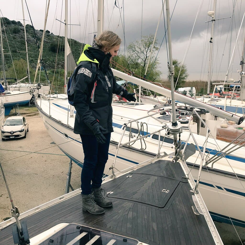 person stood on bow of boat